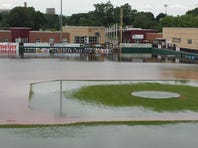 In a Saturday, June 27, 2015 photo, the Kalamazoo River flooded out of its banks, sopping Homer Stryker Field and drowning its dugouts.