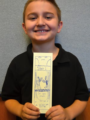 Landon Gentile-Adamson shows off his winning bookmark.