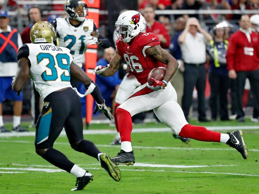 Arizona Cardinals tight end Ricky Seals-Jones (86) runs after the catch for a touchdown as Jacksonville Jaguars free safety Tashaun Gipson (39) and pursues during the first half of an NFL football game, Sunday, Nov. 26, 2017, in Glendale, Ariz. (AP Photo/Rick Scuteri)
