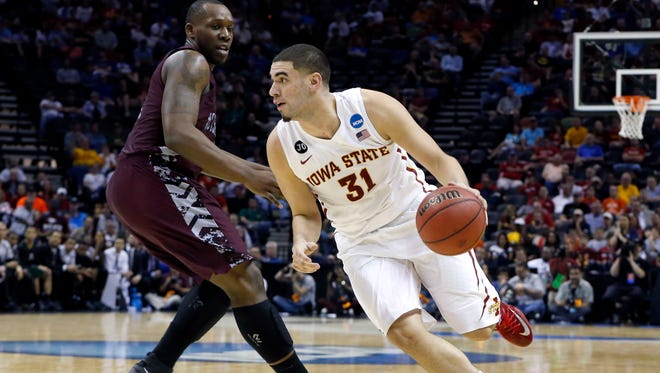Iowa State Cyclones forward Georges Niang drives against North Carolina Central Eagles forward Jay Copeland in the second half at AT&T Center.
