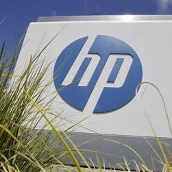 FILE - In this Aug. 21, 2012, file photo, the Hewlett-Packard Co. logo is seen outside the company's headquarters in Palo Alto, Calif. Hewlett-Packard Co. is splitting itself into two companies, one focused on its personal computer and printing business and another on technology services, such as data storage, servers and software, as it aims to drive stronger profitability. (AP Photo/Paul Sakuma, File) ORG XMIT: NY117