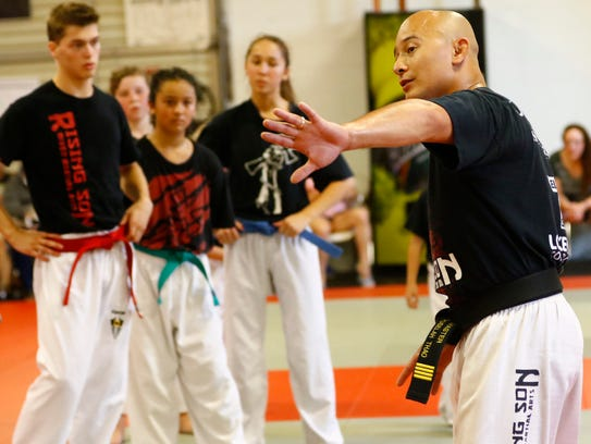 Owner and instructor Lah Thao trains his martial art