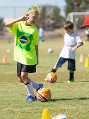 Joseph Hennessy, 6, of Las Cruces, participates in the Challenger British Soccer Camp on Thursday, May 31, 2018,  at High Noon Soccer Complex.