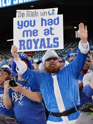 Royals fans hold up a sign before Game 7.