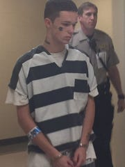 Conner Byron Hanson walks from the jail into the Minnehaha
