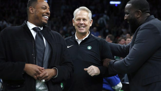 Boston Celtics president of basketball operations Danny Ainge, center, talks with former Celtics Paul Pierce, left, and Kendrick Perkins during a game against the Houston Rockets on Feb. 29.