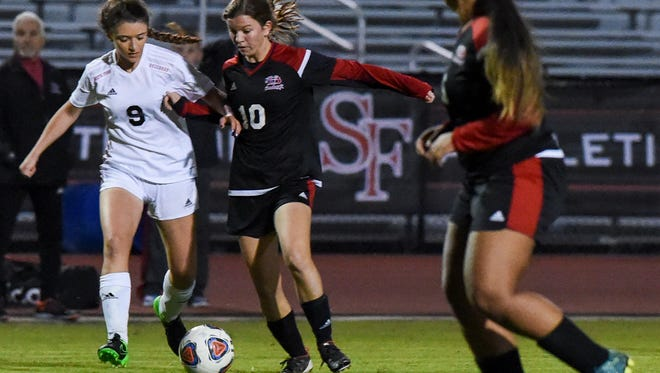 South Fork's CrystalAyn Hagberg (9) and Vero Beach's Madelaine Rhodes (10) battle for the ball Friday, Jan. 5, 2018, during their high school girls soccer match at South Fork High School in Tropical Farms. To see more photos, go to TCPalm.com.