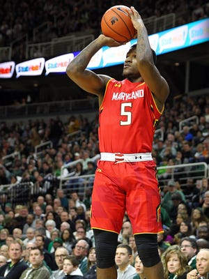 Maryland Terrapins guard Dion Wiley (5) attempts a 3 point shot during the 1st half of a game against Michigan State at Jack Breslin Student Events Center.