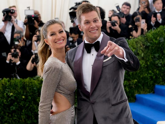 Gisele Bundchen, left, and Tom Brady attend a benefit