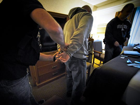 Central Minnesota Sex Trafficking Task Force members arrest a man June 3, 2016, after he responded to an internet ad and arranged to pay for sex during a sting operation at a St. Cloud hotel.