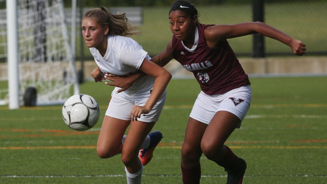 From left, Briarcliff's Julia Dalessandro (9)  and Valhalla's Sierra Lockhart (13) battle for ball control during girls soccer action in the Mount Pleasant Cup Tournament at Briarcliff High School Sept. 7, 2017. Briarcliff won the game 5-4 in overtime.