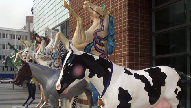 A herd of Horses on Parade are seen in front of the Blue Cross Arena in 2001.