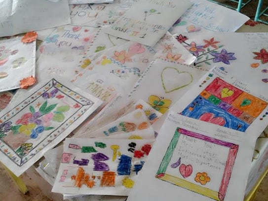 All of the students colored pictures and messages to