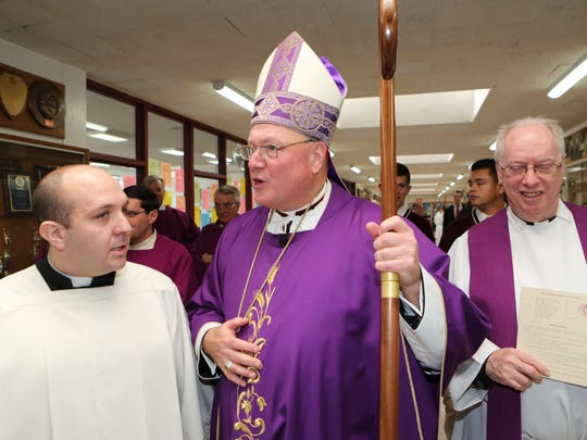 Cardinal Timothy Dolan, gets a tour of the school after celebrating Mass and before blessing the new science labs at Albertus Magnus High School in Bardonia, Dec. 16, 2015.
