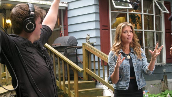 """Genevieve Gorder, right, star of HGTV's """"Dear Genevieve,"""" talks about why she's in Painted Post Wednesday morning during an in-home design consultation filming at Joy Klinkenberg's Steuben County home."""