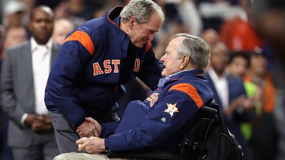 Former U.S. Presidents George H.W. Bush and George W. Bush.