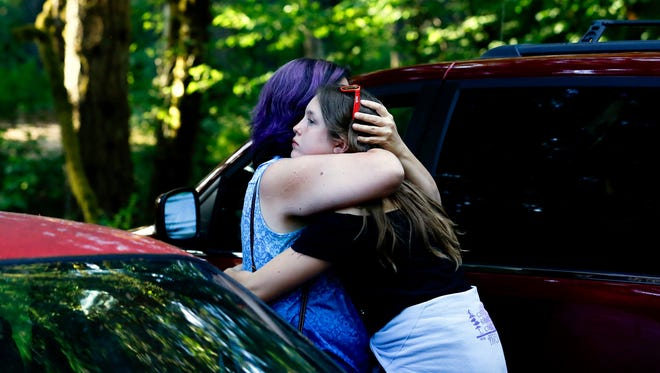 Jennifer Kimball hugs her daughter Casadie, 15, while preparing to leave Camp Silver Creek in Silver Falls State Park on Friday, July 13, 2018.