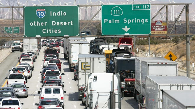 Cars and trucks sit in traffic on the Interstate 10 near the Highway 111 exit, just outside the Coachella Valley.