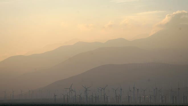Smog blows through the San Gorgonio Pass in 2011. Climate change is expected to make smog and other forms of air pollution significantly worse, which could hit hardest in parts of the Coachella Valley where asthma rates are already high.