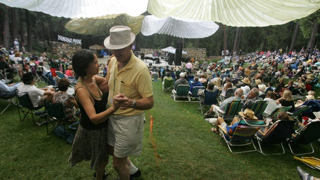 Jazz fans come up to Idyllwild every year for the annual Jazz in the Pines music festival in August. In this photo Luz Diaz and Lou Schreifer, both of South Bay dance to the music of Big Bad Voodoo Daddy in 2011.