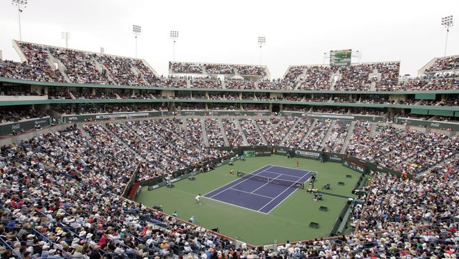 Novac Djokovic and Rafael Nadal compete in front of a full Stadium 1 during the men's final at the 2011 BNP Paribas Open.