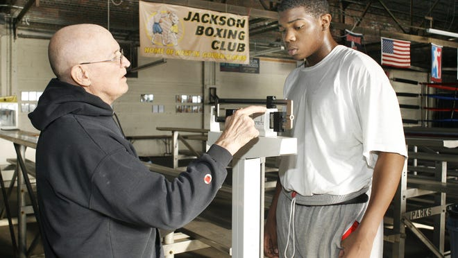 Collins weighs Jalen Williams before the West Tennessee Golden Gloves tournament in Jackson in 2010.