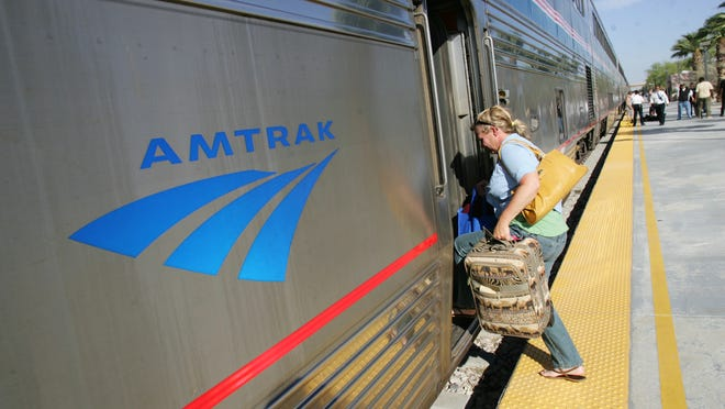 A passenger boards the eastbound Amtrak train at the Palm Springs station.