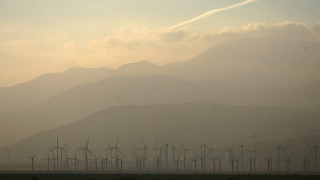 Smog blowing through the Banning Pass is seen from Palm Springs in 2011.
