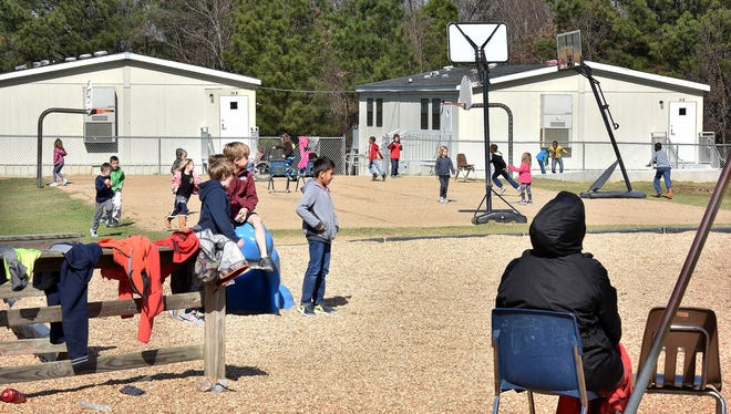 Students play in view of portable classrooms at Flowood Elementary School Thursday.