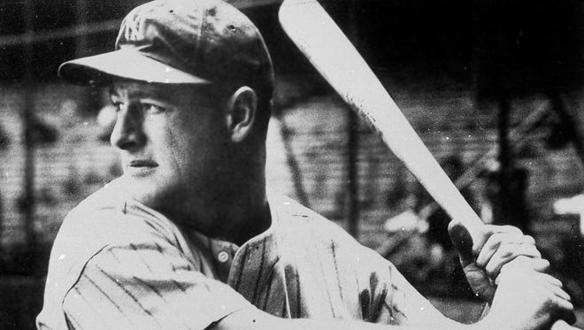 In this 1935 file photo, New York Yankees first baseman Lou Gehrig poses with a bat. Gehrig's famous speech, given as he fought ALS, celebrated its 75th anniversary on Friday, July 4.