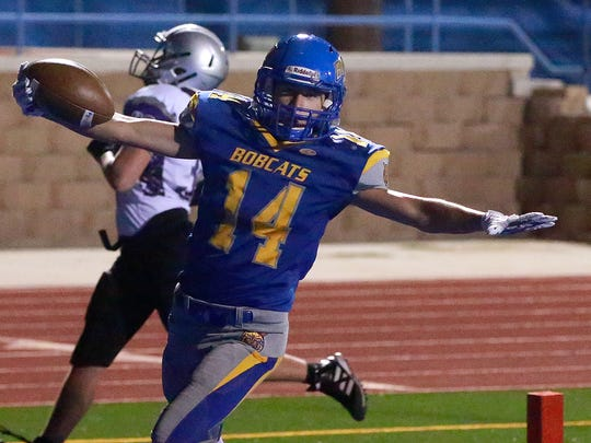 Bloomfield's Drew Smith celebrates one of his three first-half touchdowns during a 2016 game against Miyamura at Bobcat Stadium.