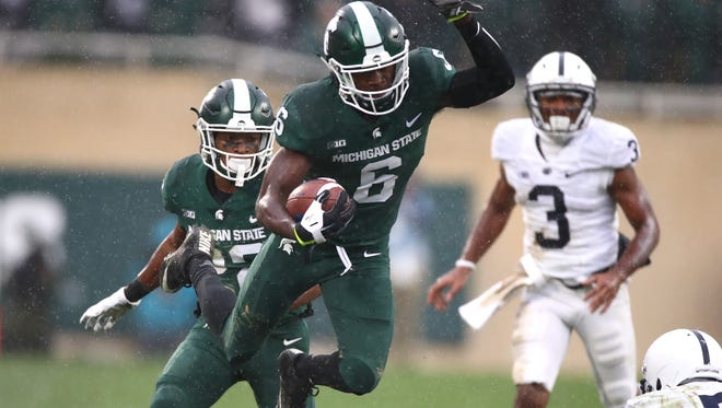 Michigan State's David Dowell runs back an interception in the second half against Penn State on Nov. 4, 2017 in East Lansing.