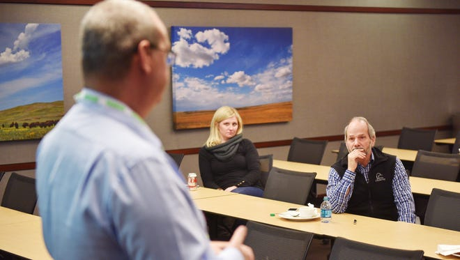 Howalt+McDowell Insurance employees Laci Dell Thompson, left, and Paul Rickert, right, listen to Safety and compliance consultants Terry Lively during the ALICE Active Aggressor Practical Training Friday, Dec. 29, at Cherapa Place in Sioux Falls.