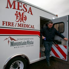 Nurse Practitioner Tom Morris leaves his unit as he answers a medical call for 25-year-old male under the influence in east Mesa on Friday, Mar. 8, 2013.