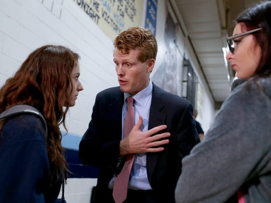 Rep. Joe Kennedy from Massachusetts talks about opioid abuse among young people with Lindsey DeShana, 14 and Emily Cauchir, 15 on Thursday, October 19, 2017 at Truman High School in Taylor.