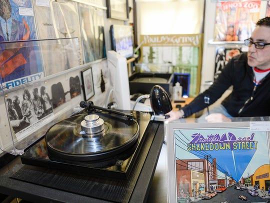 Owner Dave Frankel spins a Grateful Dead album inside
