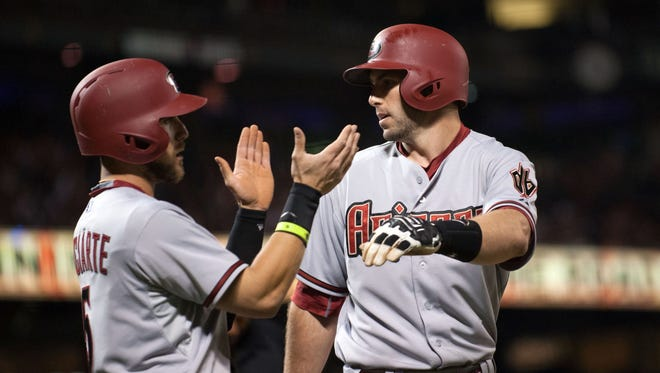 Apr 16, 2015: Arizona Diamondbacks center fielder Ender Inciarte (5) congratulates first baseman Paul Goldschmidt (44) after he hit a home run against the San Francisco Giants during the fifth inning at AT&T Park.