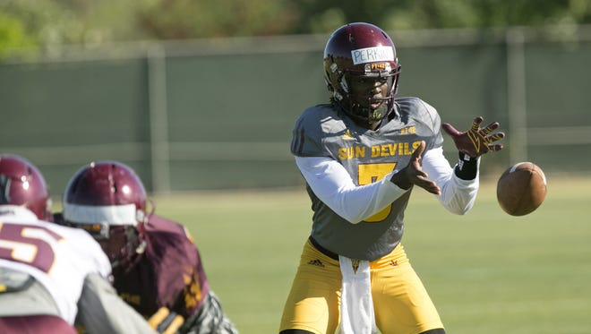ASU quarterback Bryce Perkins takes a snap during an ASU Spring football practice at the ASU practice facility in Tempe on Friday, March 25, 2016.
