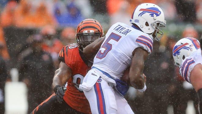 Cincinnati Bengals defensive end Michael Johnson (90) tackles Buffalo Bills quarterback Tyrod Taylor (5) for a loss in the first quarter during the Week 5 NFL game between the Buffalo Bills and the Cincinnati Bengals, Sunday, Oct. 8, 2017, at Paul Brown Stadium in CIncinnati.