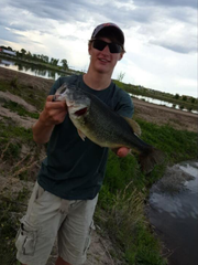 Dylan Wood displays a largemouth bass he caught. In