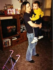This is Ashley Harrison and her son, Andrew, back in 2001. Harrison has three children.