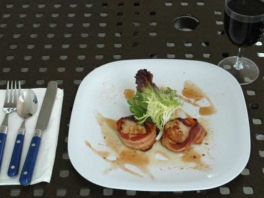 Stilts' scallop poppers appetizer is finished with