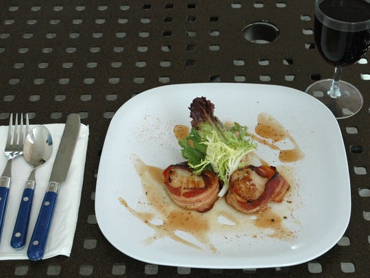 Stilts' scallop poppers appetizer is finished with a citrus buerre blanc sauce.