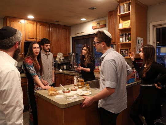The family gathers in the kitchen moments before Shabbos at the home of Bassie and Sruly Friedman Feb. 16, 2018 in Pomona.