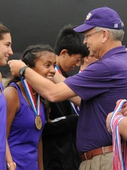 Wylie superintendent Joey Light places the state championship medal around Shruti Patel. The Bulldogs defeated Fredericksburg 10-0 in the Class 4A state finals on Thursday, Nov. 2, 2017 at the George P. Mitchell Tennis Center in College Station.