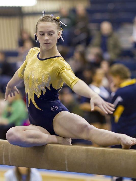 Grand Ledge sophomore Rachel Hogan completes on the balance beam during Saturday's, East Lansing Szapula Gymnastics Invitational on Jan. 4, 2014.