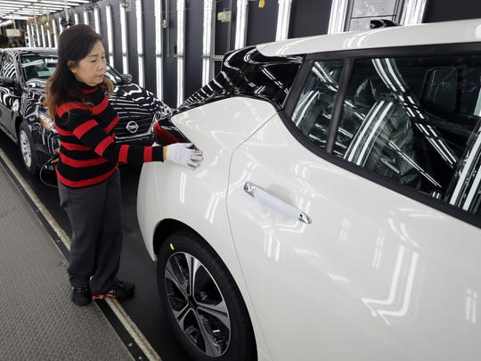 An employee at Nissan's Smyrna plant inspects a finished Nissan Leaf as it comes off the assembly line Feb. 26, 2018.