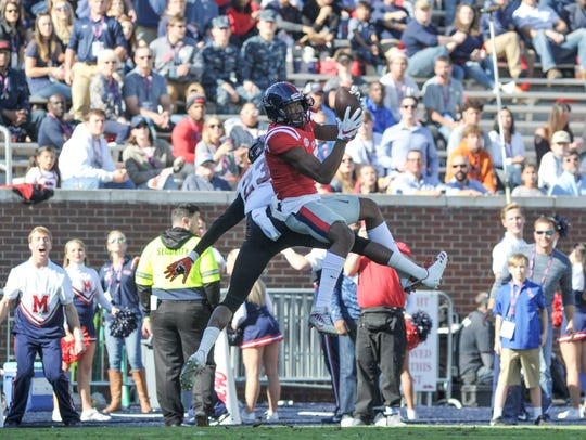 Ole Miss Rebels wide receiver DaMarkus Lodge (5) catches