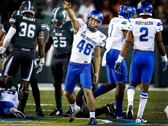 University of Memphis kicker Jake Elliott (middle)