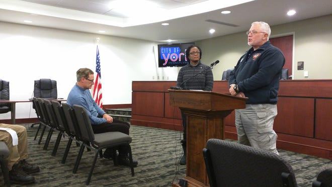 From left to right, York City Public Works Director Jim Gross, Mayor Kim Bracey and emergency services coordinator Michael Shanabrook give a news conference Tuesday.